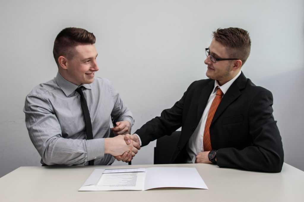 postal employee loan specialist completes loan application with client