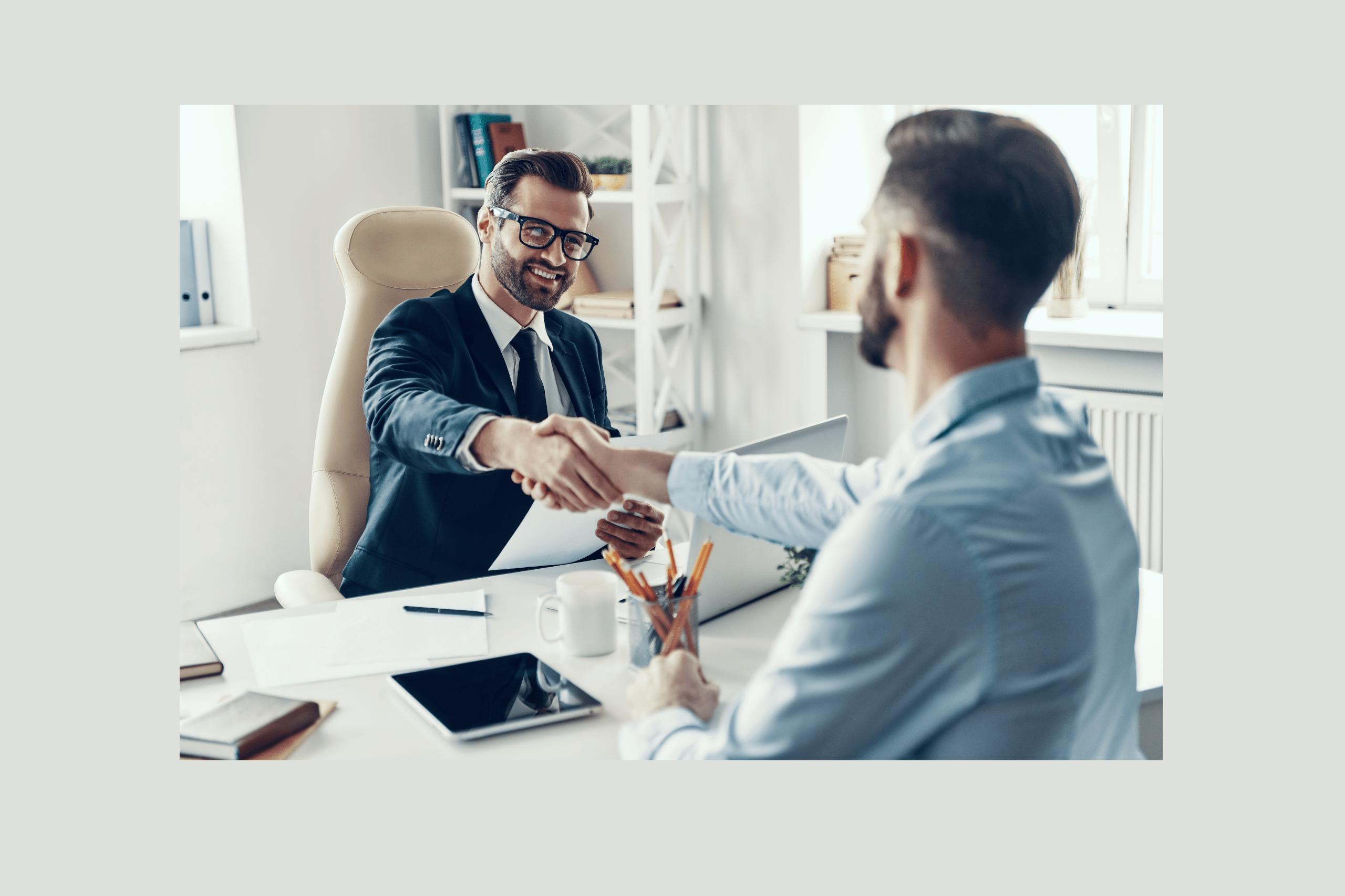 two men shaking hands in loan office
